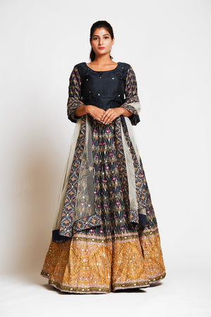 Buy beautiful black embroidered silk lehenga online in USA with mustard border and white net dupatta. Elevate your traditional Indian style with exquisite designer lehengas, Anarkali suits, traditional salwar suits from Pure Elegance Indian clothing store in USA.-front