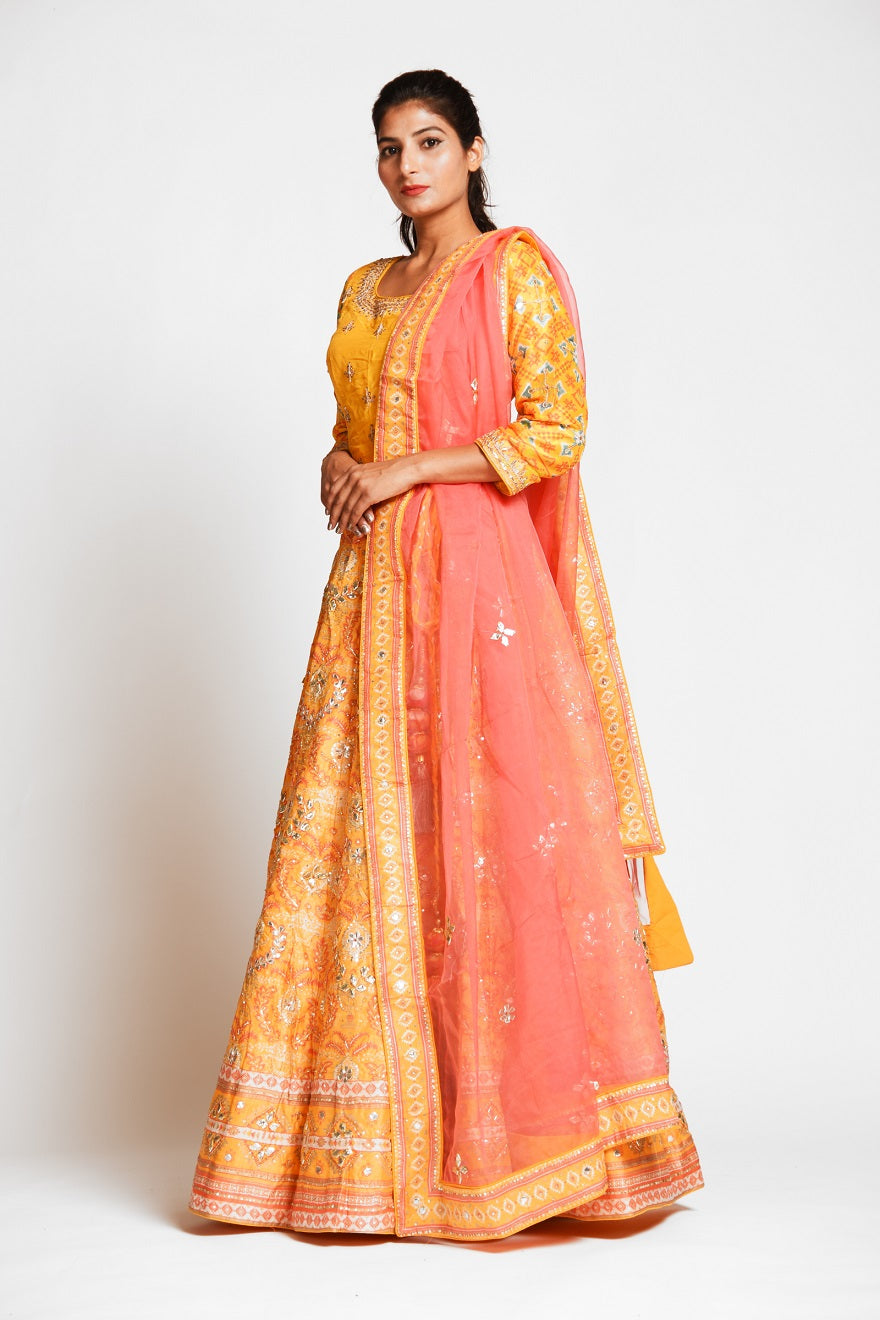 Shop captivating yellow color embroidered designer silk lehenga online in USA with pink net dupatta. Elevate your traditional Indian style with exquisite designer lehengas, Anarkali suits, traditional salwar suits from Pure Elegance Indian clothing store in USA.-side