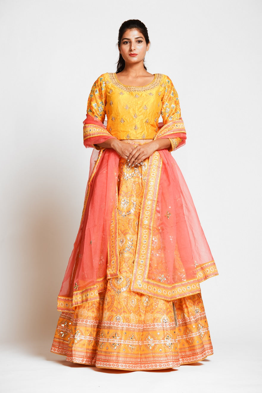 Shop captivating yellow color embroidered designer silk lehenga online in USA with pink net dupatta. Elevate your traditional Indian style with exquisite designer lehengas, Anarkali suits, traditional salwar suits from Pure Elegance Indian clothing store in USA.-front
