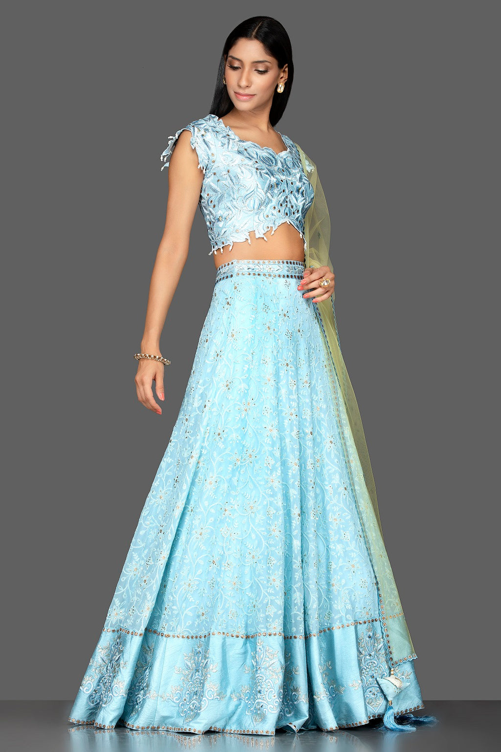 Shop sky blue stone and Lucknowi work georgette lehenga online in USA with green net dupatta. Spread ethnic elegance on weddings and special occasions in splendid designer lehengas, Indowestern dresses crafted with exquisite Indian craftsmanship from Pure Elegance Indian fashion store in USA.-full view