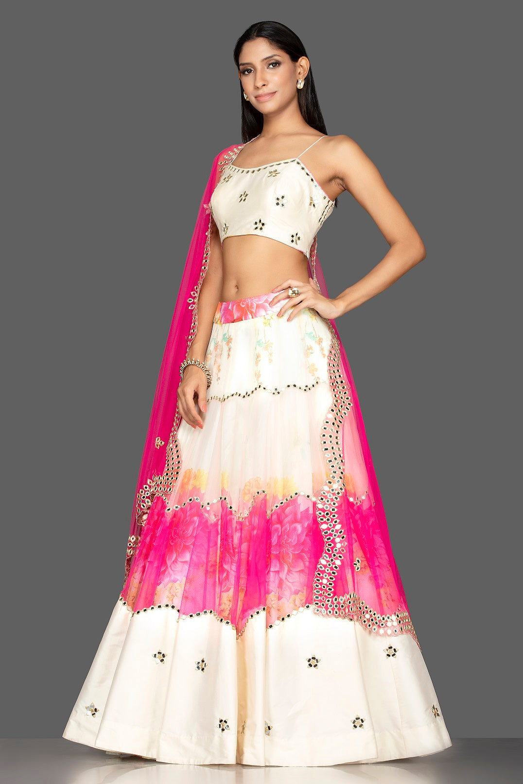 Buy beautiful cream and pink organza mirror work lehenga online in USA with matching dupatta. Spread ethnic elegance on weddings and special occasions in splendid designer lehengas, Indowestern dresses crafted with exquisite Indian craftsmanship from Pure Elegance Indian fashion store in USA.-full view
