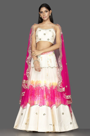 Buy beautiful cream and pink organza mirror work lehenga online in USA with matching dupatta. Spread ethnic elegance on weddings and special occasions in splendid designer lehengas, Indowestern dresses crafted with exquisite Indian craftsmanship from Pure Elegance Indian fashion store in USA.-front