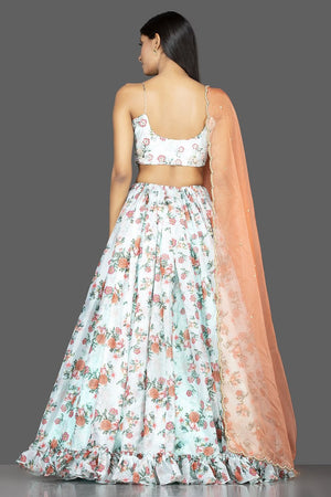 Buy mint green embroidered organza floral lehenga online in USA with peach dupatta. Spread ethnic elegance on weddings and special occasions in splendid designer lehengas, Indowestern dresses crafted with exquisite Indian craftsmanship from Pure Elegance Indian fashion store in USA.-back