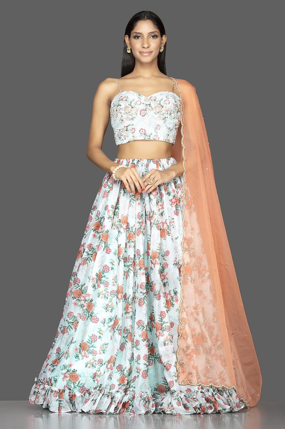 Buy mint green embroidered organza floral lehenga online in USA with peach dupatta. Spread ethnic elegance on weddings and special occasions in splendid designer lehengas, Indowestern dresses crafted with exquisite Indian craftsmanship from Pure Elegance Indian fashion store in USA.-front