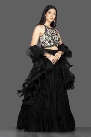 Buy gorgeous black georgette lehenga online in USA with ruffle dupatta and embroidered blouse. Spread ethnic elegance on weddings and special occasions in splendid designer lehengas, Indowestern dresses crafted with exquisite Indian craftsmanship from Pure Elegance Indian fashion store in USA.-side
