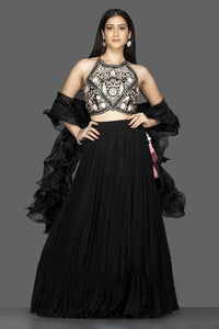 Buy gorgeous black georgette lehenga online in USA with ruffle dupatta and embroidered blouse. Spread ethnic elegance on weddings and special occasions in splendid designer lehengas, Indowestern dresses crafted with exquisite Indian craftsmanship from Pure Elegance Indian fashion store in USA.-full view