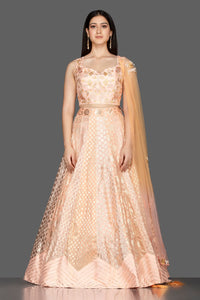 Shop elegant peach embroidered net and silk lehenga online in USA with matching dupatta. Spread ethnic elegance on weddings and special occasions in splendid designer lehengas, Indowestern dresses crafted with exquisite Indian craftsmanship from Pure Elegance Indian fashion store in USA.-full view