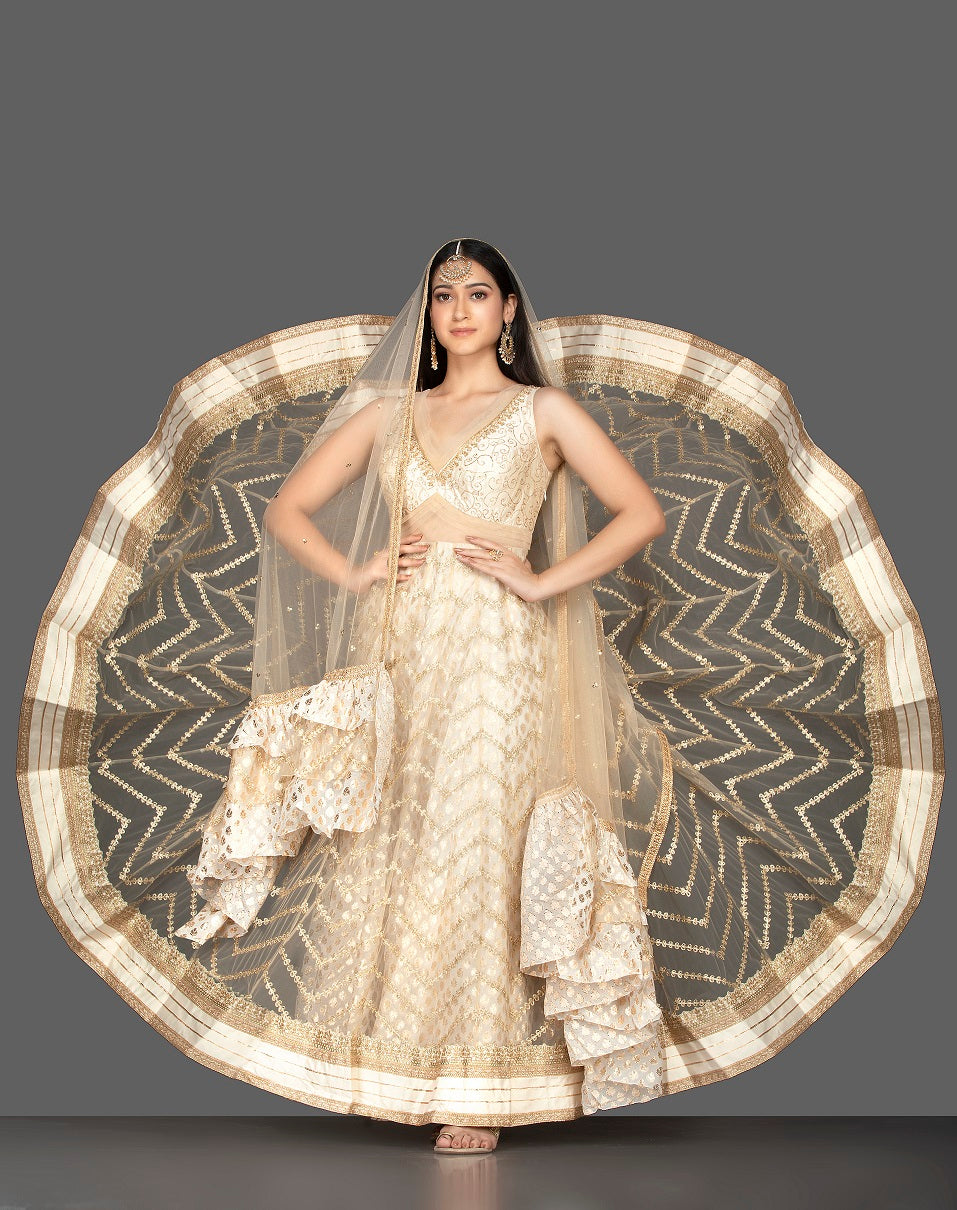 Shop gorgeous cream embroidered net floorlength Anarkali online in USA with dupatta. Spread ethnic elegance on weddings and special occasions in splendid designer lehengas, Anarkali suits crafted with exquisite Indian craftsmanship from Pure Elegance Indian fashion store in USA.-full view