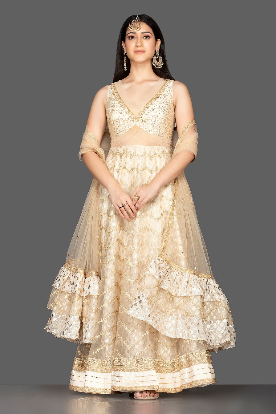 Shop gorgeous cream embroidered net floorlength Anarkali online in USA with dupatta. Spread ethnic elegance on weddings and special occasions in splendid designer lehengas, Anarkali suits crafted with exquisite Indian craftsmanship from Pure Elegance Indian fashion store in USA.-front