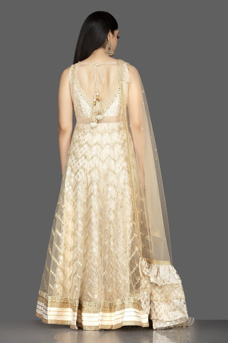 Shop gorgeous cream embroidered net floorlength Anarkali online in USA with dupatta. Spread ethnic elegance on weddings and special occasions in splendid designer lehengas, Anarkali suits crafted with exquisite Indian craftsmanship from Pure Elegance Indian fashion store in USA.-back