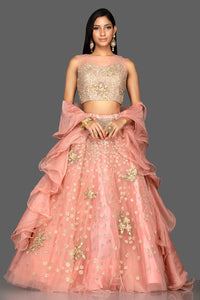 Shop exquisite dusty pink zardozi embroidery net lehenga online in USA with net dupatta. Look radiant on weddings and special occasions in splendid designer lehengas crafted with finest embroideries and stunning silhouettes from Pure Elegance Indian fashion boutique in USA.-full view