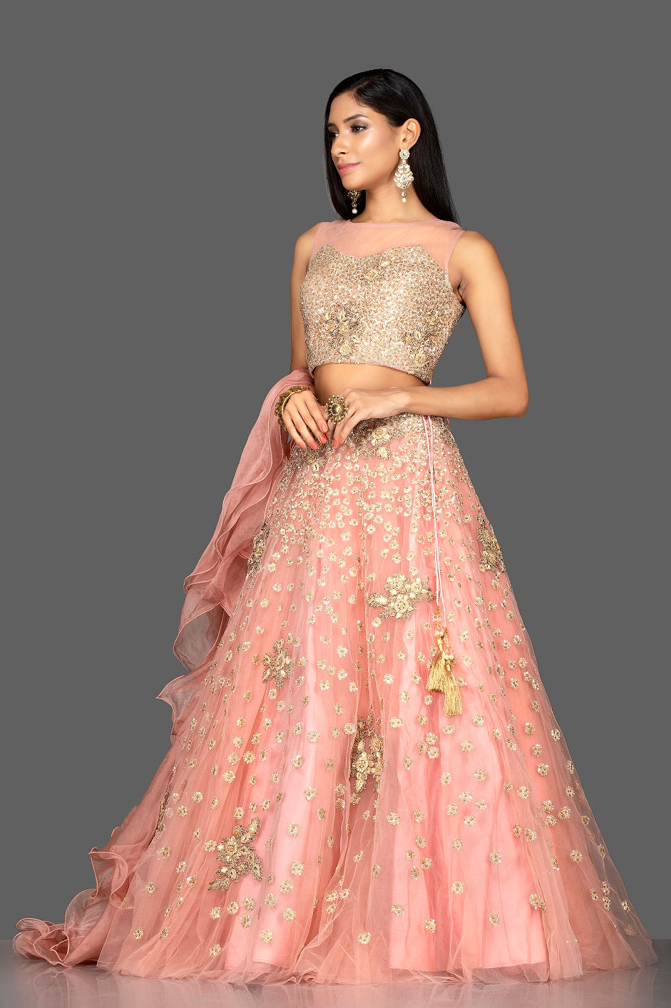 Shop exquisite dusty pink zardozi embroidery net lehenga online in USA with net dupatta. Look radiant on weddings and special occasions in splendid designer lehengas crafted with finest embroideries and stunning silhouettes from Pure Elegance Indian fashion boutique in USA..-side