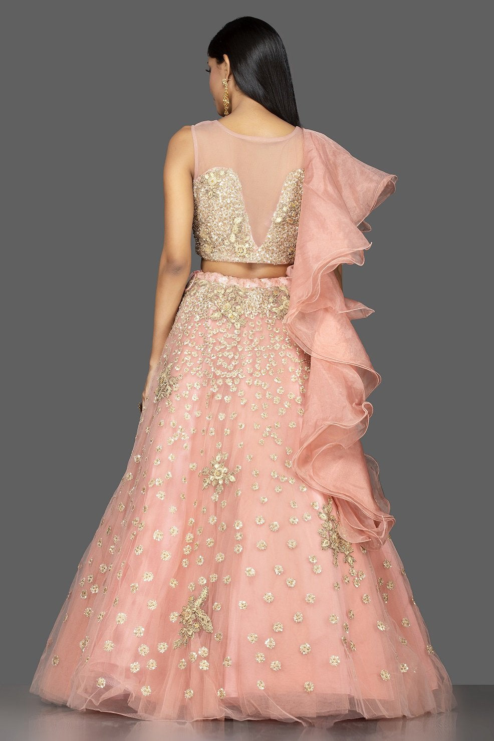 Shop exquisite dusty pink zardozi embroidery net lehenga online in USA with net dupatta. Look radiant on weddings and special occasions in splendid designer lehengas crafted with finest embroideries and stunning silhouettes from Pure Elegance Indian fashion boutique in USA..-back