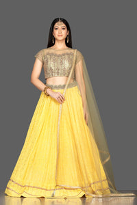 Buy lovely yellow and golden Lucknowi work georgette lehenga online in USA with net dupatta. Look radiant on weddings and special occasions in splendid designer lehengas crafted with finest embroideries and stunning silhouettes from Pure Elegance Indian fashion boutique in USA.-full view