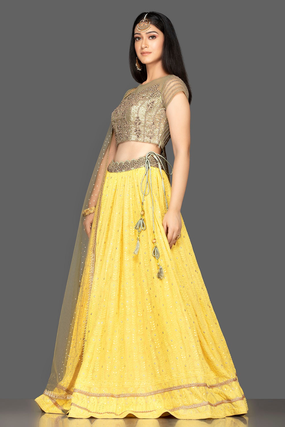 Buy lovely yellow and golden Lucknowi work georgette lehenga online in USA with net dupatta. Look radiant on weddings and special occasions in splendid designer lehengas crafted with finest embroideries and stunning silhouettes from Pure Elegance Indian fashion boutique in USA.-side