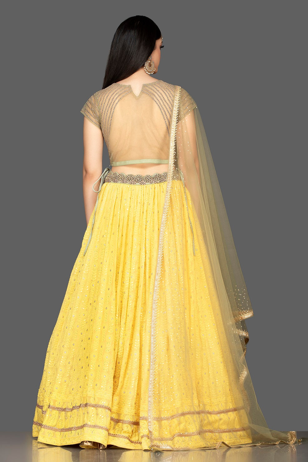 Buy lovely yellow and golden Lucknowi work georgette lehenga online in USA with net dupatta. Look radiant on weddings and special occasions in splendid designer lehengas crafted with finest embroideries and stunning silhouettes from Pure Elegance Indian fashion boutique in USA.-back