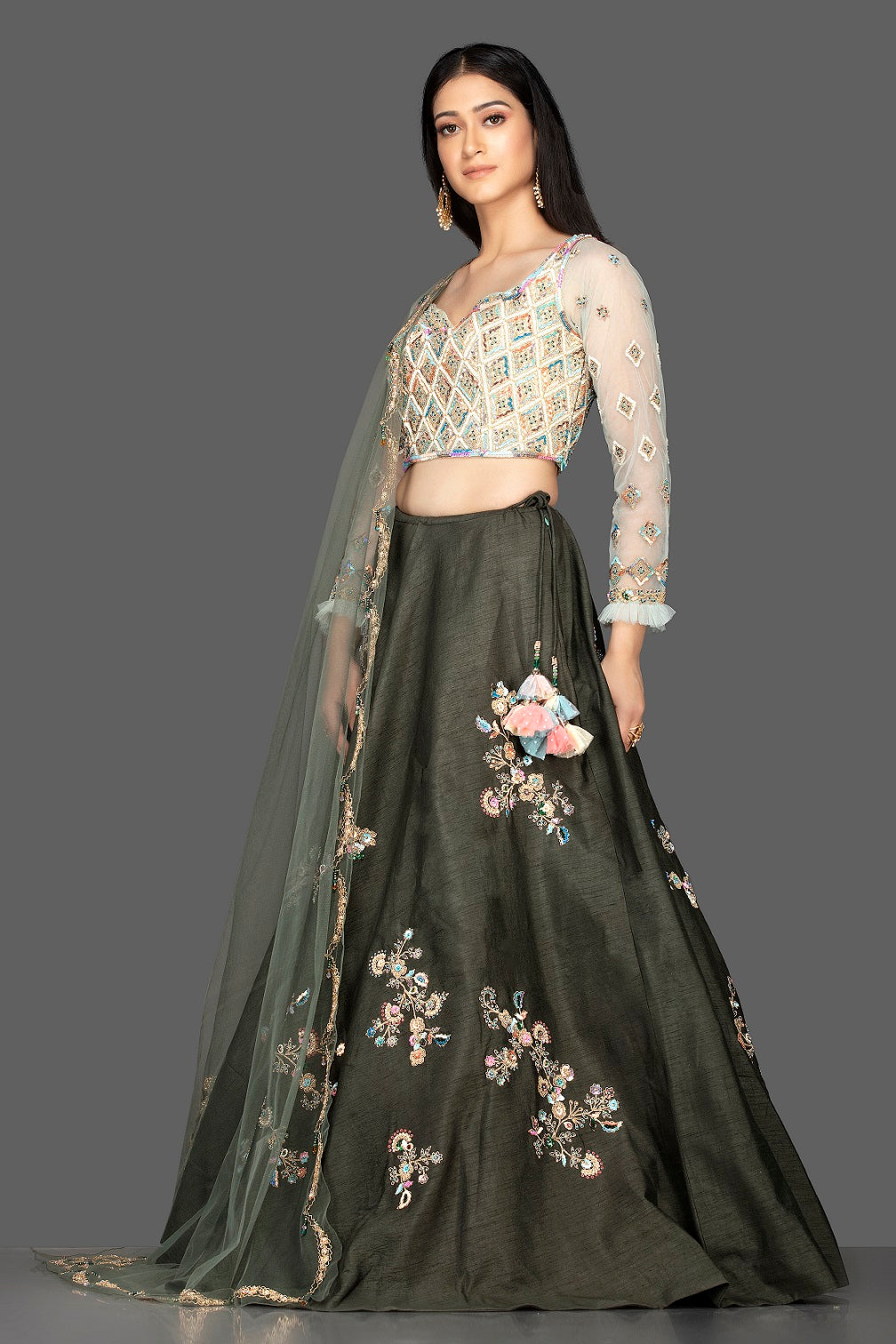 Buy beautiful dark grey embroidered raw silk lehenga online in USA with net dupatta. Look radiant on weddings and special occasions in splendid designer lehengas crafted with finest embroideries and stunning silhouettes from Pure Elegance Indian fashion boutique in USA.-full view