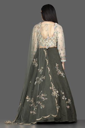 Buy beautiful dark grey embroidered raw silk lehenga online in USA with net dupatta. Look radiant on weddings and special occasions in splendid designer lehengas crafted with finest embroideries and stunning silhouettes from Pure Elegance Indian fashion boutique in USA.-back