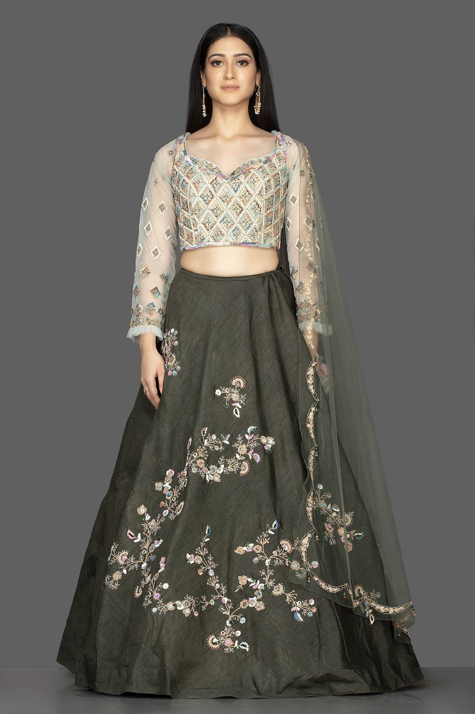 Buy beautiful dark grey embroidered raw silk lehenga online in USA with net dupatta. Look radiant on weddings and special occasions in splendid designer lehengas crafted with finest embroideries and stunning silhouettes from Pure Elegance Indian fashion boutique in USA.-front
