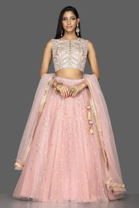 Buy stunning pale pink embroidered net lehenga online in USA with martching net dupatta. Look radiant on weddings and special occasions in splendid designer lehengas crafted with finest embroideries and stunning silhouettes from Pure Elegance Indian fashion boutique in USA.-full view