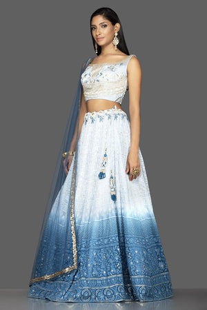 Shop charming ombre blue Lucknowi work georgette lehenga online in USA with matching net dupatta. Look radiant on weddings and special occasions in splendid designer lehengas crafted with finest embroideries and stunning silhouettes from Pure Elegance Indian fashion boutique in USA.-side