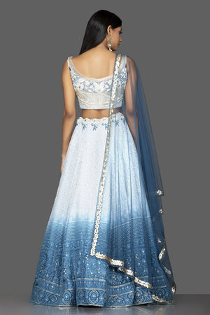 Shop charming ombre blue Lucknowi work georgette lehenga online in USA with matching net dupatta. Look radiant on weddings and special occasions in splendid designer lehengas crafted with finest embroideries and stunning silhouettes from Pure Elegance Indian fashion boutique in USA.-back