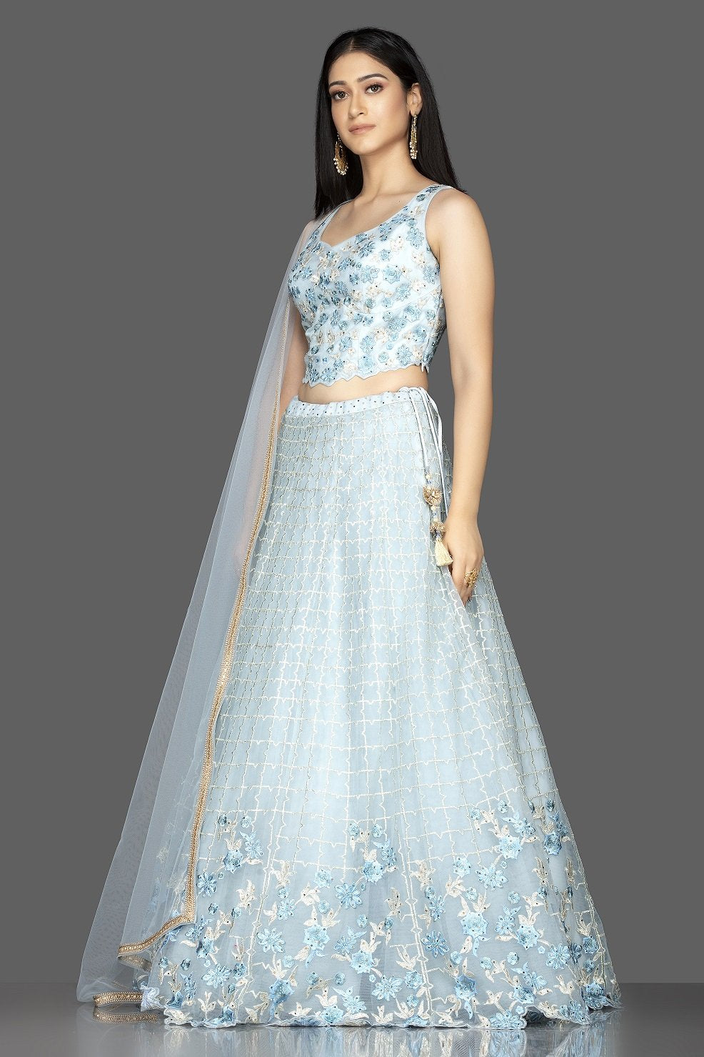 Buy beautiful powder blue embroidered designer net lehenga online in USA with matching net dupatta. Look radiant on weddings and special occasions in splendid designer lehengas crafted with finest embroideries and stunning silhouettes from Pure Elegance Indian fashion boutique in USA.-side