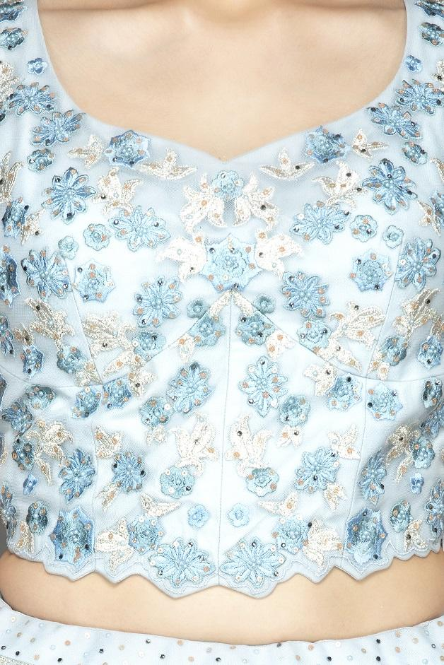 Buy beautiful powder blue embroidered designer net lehenga online in USA with matching net dupatta. Look radiant on weddings and special occasions in splendid designer lehengas crafted with finest embroideries and stunning silhouettes from Pure Elegance Indian fashion boutique in USA.-blouse