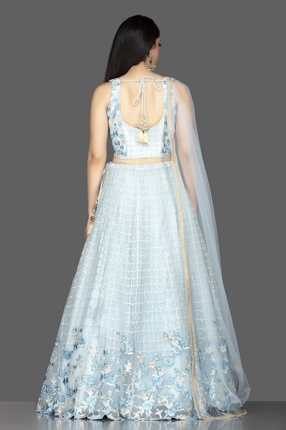 Buy beautiful powder blue embroidered designer net lehenga online in USA with matching net dupatta. Look radiant on weddings and special occasions in splendid designer lehengas crafted with finest embroideries and stunning silhouettes from Pure Elegance Indian fashion boutique in USA.-back
