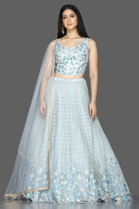 Buy beautiful powder blue embroidered designer net lehenga online in USA with matching net dupatta. Look radiant on weddings and special occasions in splendid designer lehengas crafted with finest embroideries and stunning silhouettes from Pure Elegance Indian fashion boutique in USA.-full view