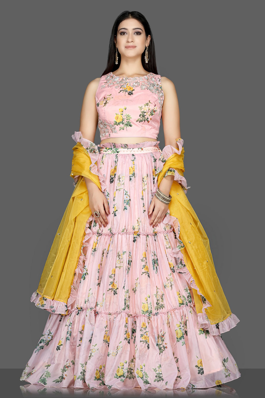 Buy stunning powder pink floral organza silk lehenga online in USA with yellow dupatta. Flaunt ethnic fashion with exquisite designer lehenga, Indian wedding dresses from Pure Elegance Indian fashion boutique in USA.-full view