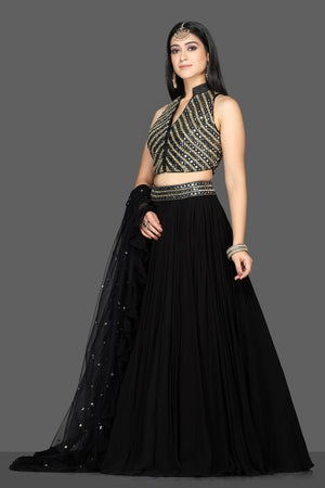 Shop beautiful black embroidered net lehenga online in USA with dupatta. Flaunt ethnic fashion with exquisite designer lehenga, Indian wedding dresses from Pure Elegance Indian fashion boutique in USA.-side