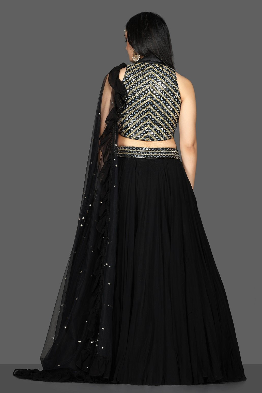 Shop beautiful black embroidered net lehenga online in USA with dupatta. Flaunt ethnic fashion with exquisite designer lehenga, Indian wedding dresses from Pure Elegance Indian fashion boutique in USA.-back