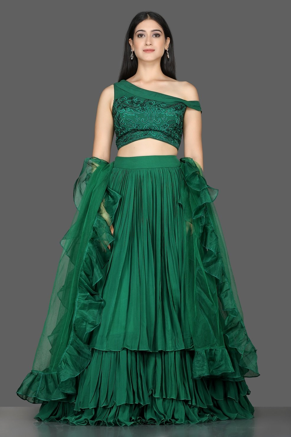 Buy stylish bottle green georgette layered lehenga online in USA with ruffle dupatta. Flaunt ethnic fashion with exquisite designer lehenga, Indian wedding dresses from Pure Elegance Indian fashion boutique in USA.-full view