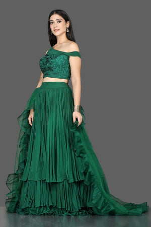 Buy stylish bottle green georgette layered lehenga online in USA with ruffle dupatta. Flaunt ethnic fashion with exquisite designer lehenga, Indian wedding dresses from Pure Elegance Indian fashion boutique in USA.-side