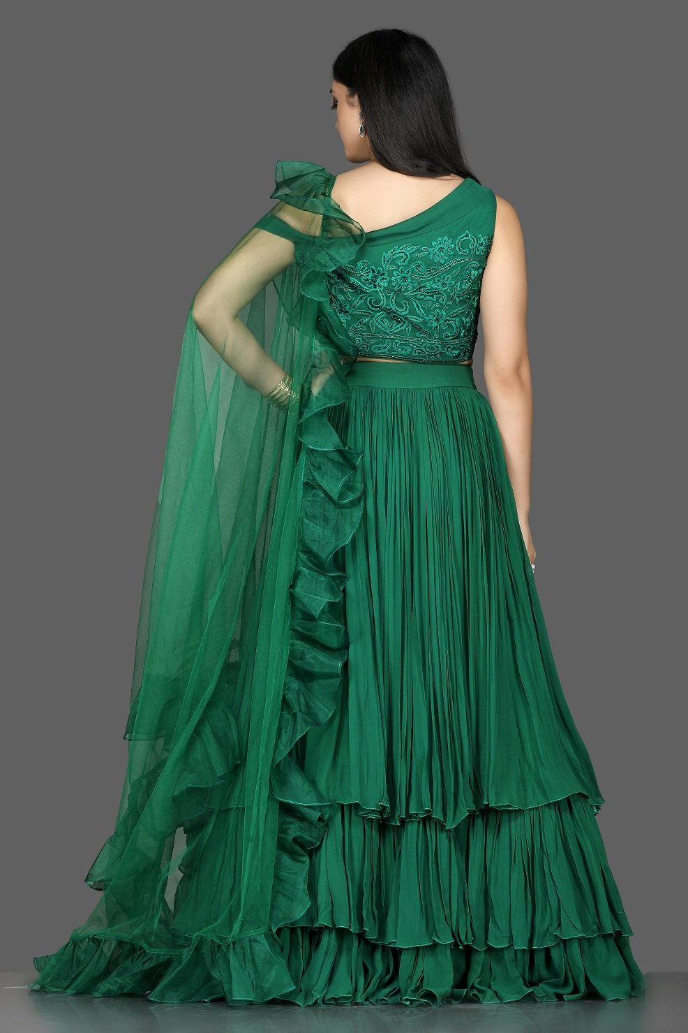 Buy stylish bottle green georgette layered lehenga online in USA with ruffle dupatta. Flaunt ethnic fashion with exquisite designer lehenga, Indian wedding dresses from Pure Elegance Indian fashion boutique in USA.-back