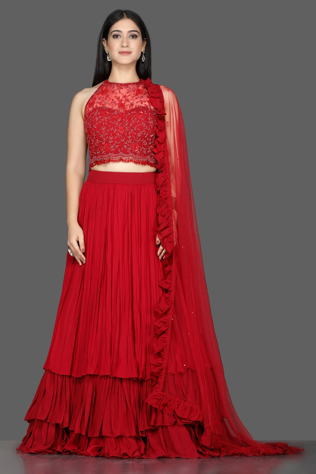 Buy gorgeous red embroidered layered georgette lehenga online in USA with ruffle dupatta. Flaunt ethnic fashion with exquisite designer lehenga, Indian wedding dresses from Pure Elegance Indian fashion boutique in USA.-full view