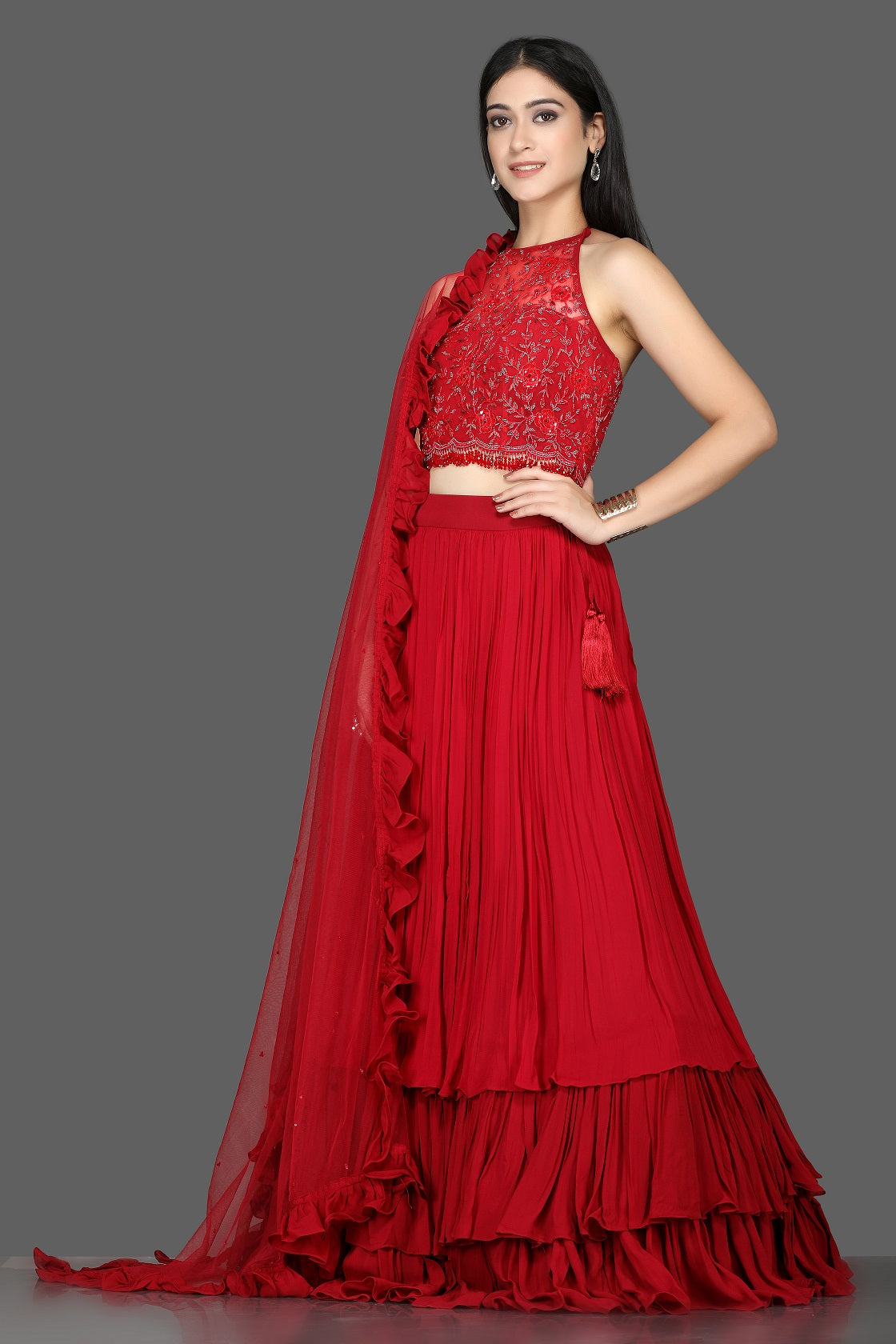 Buy gorgeous red embroidered layered georgette lehenga online in USA with ruffle dupatta. Flaunt ethnic fashion with exquisite designer lehenga, Indian wedding dresses from Pure Elegance Indian fashion boutique in USA.-side