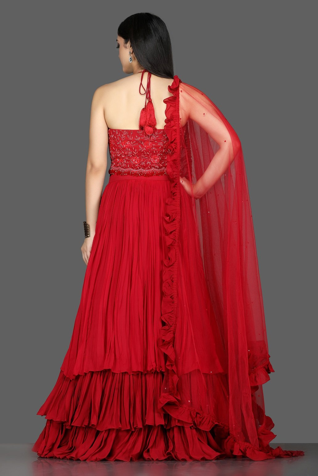 Buy gorgeous red embroidered layered georgette lehenga online in USA with ruffle dupatta. Flaunt ethnic fashion with exquisite designer lehenga, Indian wedding dresses from Pure Elegance Indian fashion boutique in USA.-back