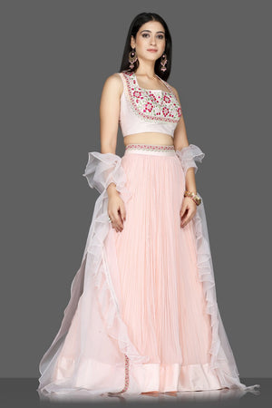 Buy lovely powder pink embroidered georgette lehenga online in USA with organza cape. Flaunt ethnic fashion with exquisite designer lehenga, Indian wedding dresses from Pure Elegance Indian fashion boutique in USA.-side