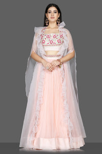 Buy lovely powder pink embroidered georgette lehenga online in USA with organza cape. Flaunt ethnic fashion with exquisite designer lehenga, Indian wedding dresses from Pure Elegance Indian fashion boutique in USA.-full view