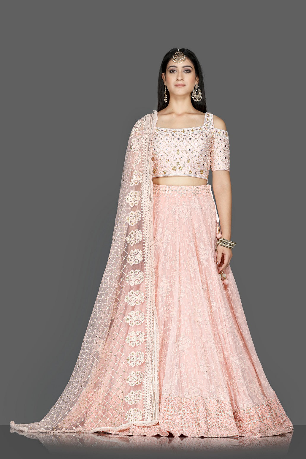 Buy gorgeous powder pink embroidered georgette lehenga online in USA with dupatta. Go for an attractive wedding style with Pure Elegance designer lehengas. traditional salwar suits, Indowestern dresses available at our exclusive Indian fashion store in USA.-full view