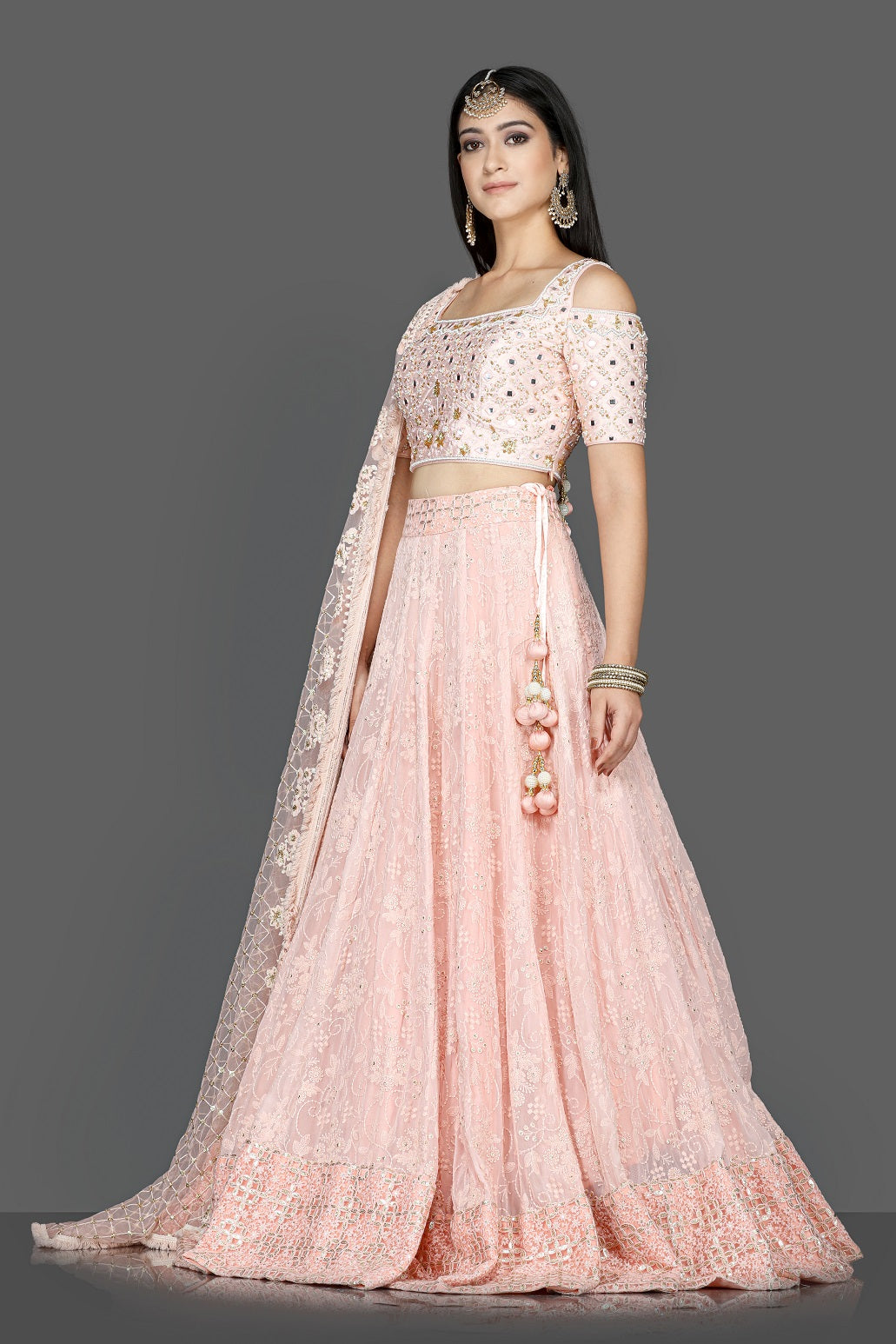 Buy gorgeous powder pink embroidered georgette lehenga online in USA with dupatta. Go for an attractive wedding style with Pure Elegance designer lehengas. traditional salwar suits, Indowestern dresses available at our exclusive Indian fashion store in USA.-side