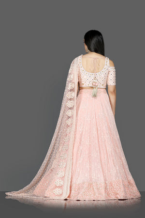 Buy gorgeous powder pink embroidered georgette lehenga online in USA with dupatta. Go for an attractive wedding style with Pure Elegance designer lehengas. traditional salwar suits, Indowestern dresses available at our exclusive Indian fashion store in USA.-back
