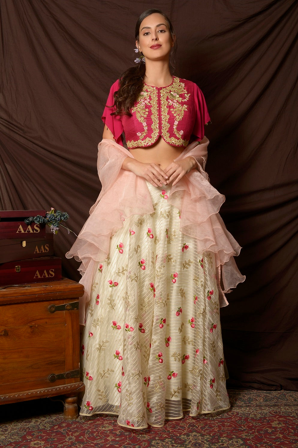 Shop gorgeous pink peplum cape embroidered organza lehenga online in USA. Shine at weddings and special occasions with beautiful Indian designer dresses, gowns, lehengas from Pure Elegance Indian clothing store in USA.-full view
