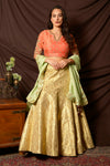 Shop gorgeous peach and gold embroidered brocade lehenga online in USA with pista green dupatta. Shine at weddings and special occasions with beautiful Indian designer dresses, gowns, lehengas from Pure Elegance Indian clothing store in USA.-full view