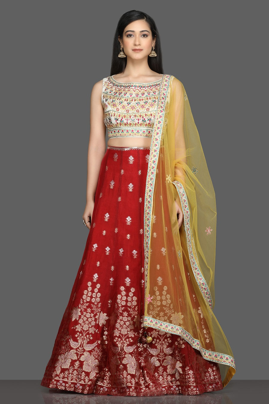 Buy beautiful cream and red embroidered lehenga online in USA with yellow dupatta. Dazzle on weddings and special occasions with exquisite Indian designer dresses, sharara suits, Anarkali suits, bridal lehegas from Pure Elegance Indian fashion store in USA.-full view