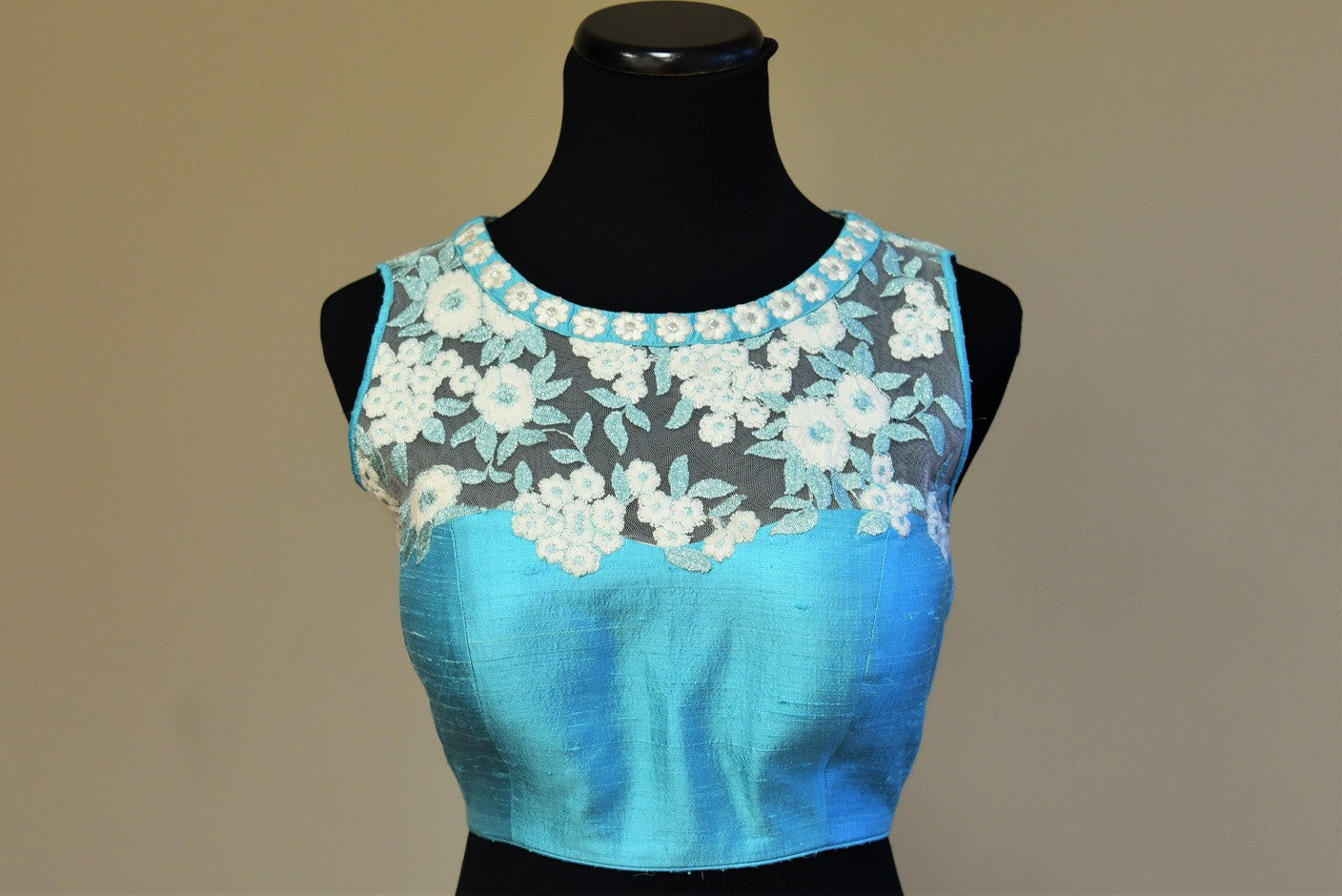 Shop this traditional Indian turquoise blue raw silk blouse having lace embroidery online or our Pure Elegance store in USA. Perfect for any reception party. Blue and White.
