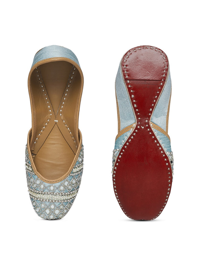 Shop pale blue sequin, bead and mirror embroidery jutti online in USA. Grab beautiful designer footwear and ethnic juttis in USA from Pure Elegance Indian fashion store in USA. Enhance your ethnic attires with exquisite accessories available on our online store.-front