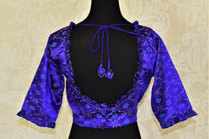 Shop lovely blue silk ikkat saree blouse online in USA with frill details. Enhance your traditional sarees at weddings and festive occasions with designer saree blouses from Pure Elegance Indian clothing store in USA.-back